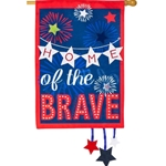 Red, white and blue banner with stars and fireworks and lettering reading Home of the Brave.