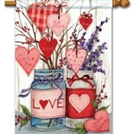 mason jars, valentine messages, ribbons, flowers in printed arrangement against a white background