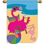 Pink flamingo, relaxing in beach chair with drink in hand, ocean in background
