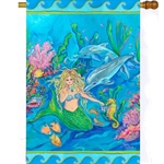 Mermaid and sea creatures playing together in bright aqua underwater environment