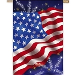 Artistic US flag waving with subtle sparkle, firework highlights in background