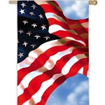 Artistic rendition of US flag, waving against clouds and blue sky.