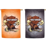 Harley Davidson Motor Cycles motif superimposed against a side view of flying eagle wrapped in a pale gold banner, all against an orange background on one side of flag and gray on the other.