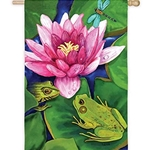 Yellow green frog in lower right hand corner sitting on and surrounded by darker green lily pads; one bright pink lily in center of flag with another from peaking out from underneath it.  A little bit of blue water is seen beneath the lily.